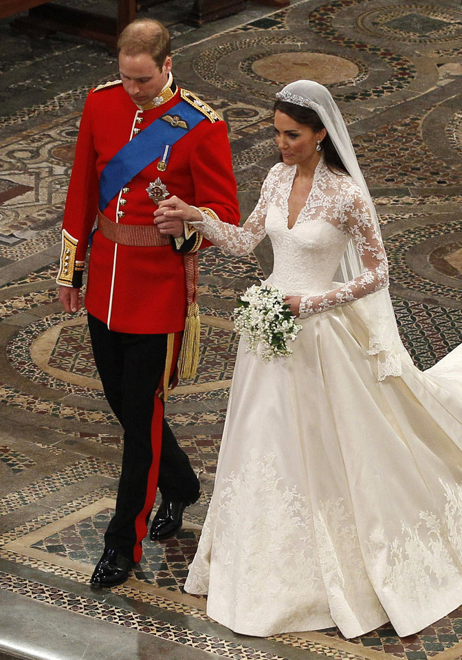 Photo - Britain's Prince William, left, and his wife Kate, the Duchess of Cambridge, right, walk hand in hand during their wedding service at Westminster Abbey in London, Friday, April 29, 2011. (AP Photo/Kirsty Wigglesworth, Pool) ORG XMIT: LKW105