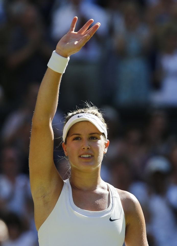 Photo - Eugenie Bouchard of Canada waves to the crowd after defeating Simona Halep of Romania in their women's singles semifinal match at the All England Lawn Tennis Championships in Wimbledon, London, Thursday, July 3, 2014. (AP Photo/Ben Curtis)