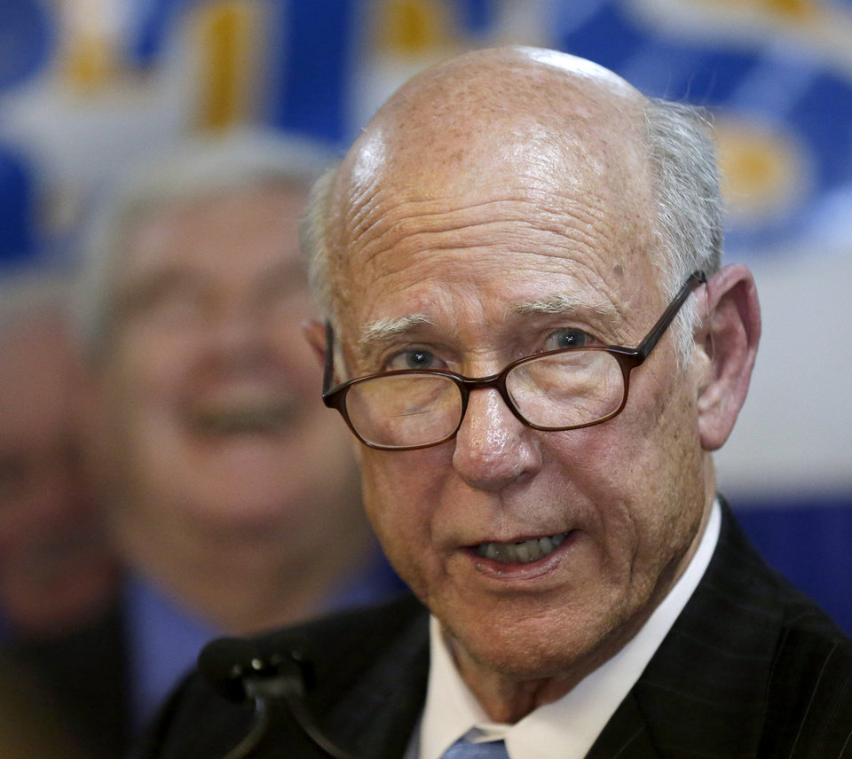 Photo - U.S. Sen. Pat Roberts speaks while former presidential candidate and U.S. House Speaker Newt Gingrich laughs in the background during an appearance for Robert's Senate re-election campaign Friday, Nov. 8, 2013, in Overland Park, Kan. (AP Photo/Charlie Riedel)