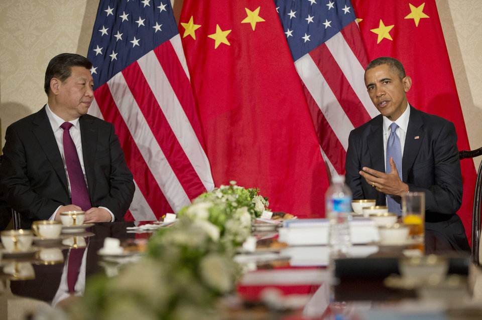 Photo - US President Barack Obama during a bilateral meeting with Chinese President Xi Jinping at the US Ambassador's Residence in Amsterdam, Netherlands, Monday, March 24, 2014. Obama is in the Netherlands for the Nuclear Security Summit in The Hague, which will form the backdrop for an emergency meeting of Group of Seven leaders on Russia's annexation of Crimea. (AP Photo/Pablo Martinez Monsivais)