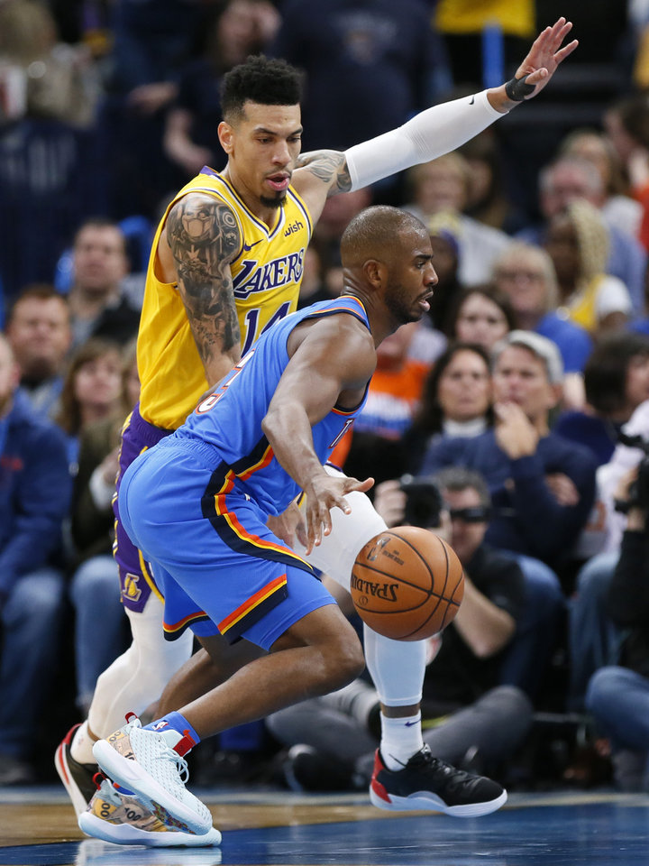 Photo - Oklahoma City's Chris Paul (3) dribbles as Los Angeles' Danny Green (14) defends in the third quarter during an NBA basketball game between the Oklahoma City Thunder and the Los Angeles Lakers at Chesapeake Energy Arena in Oklahoma City, Friday, Nov. 22, 2019. The Lakers won 130-127. [Nate Billings/The Oklahoman]