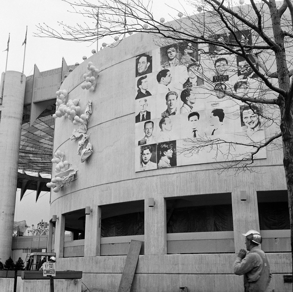 "Photo - This April 1964 photo provided by The Andy Warhol Foundation for the Visual Arts, Inc. shows a 20x20 foot mural depicting mug shots of the NYPD's 13 most-wanted criminals by Andy Warhol, mounted on the curved facade of the New York State Pavilion at the 1964 New York World's Fair in the Queens borough of New York. The fair celebrated ""The World of Tomorrow,"" but Warhol may have been ahead of his time. His monumental piece commissioned specifically for the fair was deemed too edgy for the family-friendly event and painted over just before opening day. Now, 50 years later, the work is the focus of a museum exhibition being staged on the very fairgrounds where the pop-art provocateur was infamously censored. (AP Photo/The Andy Warhol Foundation for the Visual Arts, Inc./Artists Rights Society)"