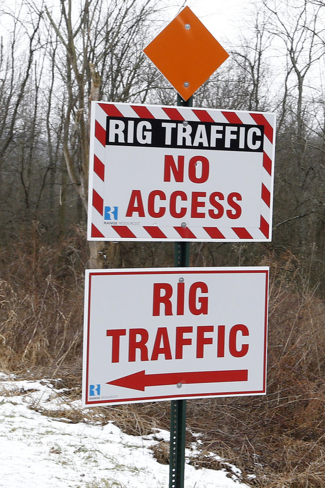 Photo - In this Friday, Jan. 10, 2014 photo, a traffic sign directs gas well trucks driving through Cross Creek County park in Avella, Pa. Gas well royalty money from wells under the park are helping pay for maintenance and improvements in western Pennsylvania's  Washington County parks. Local officials say the deals have worked well, and that they have few other options to generate new funds. But some residents don't like drilling taking place under public land.(AP Photo/Keith Srakocic)