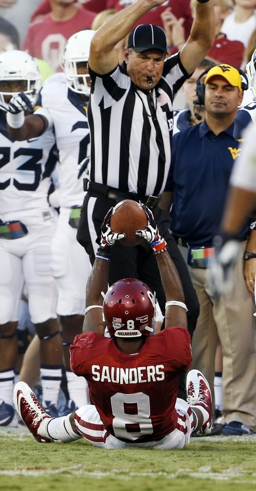 Photo - Oklahoma wide receiver Jalen Saunders (8) comes up with a pass during a college football game between the University of Oklahoma Sooners (OU) and the West Virginia University Mountaineers at Gaylord Family-Oklahoma Memorial Stadium in Norman, Okla., on Saturday, Sept. 7, 2013. Photo by Steve Sisney, The Oklahoman