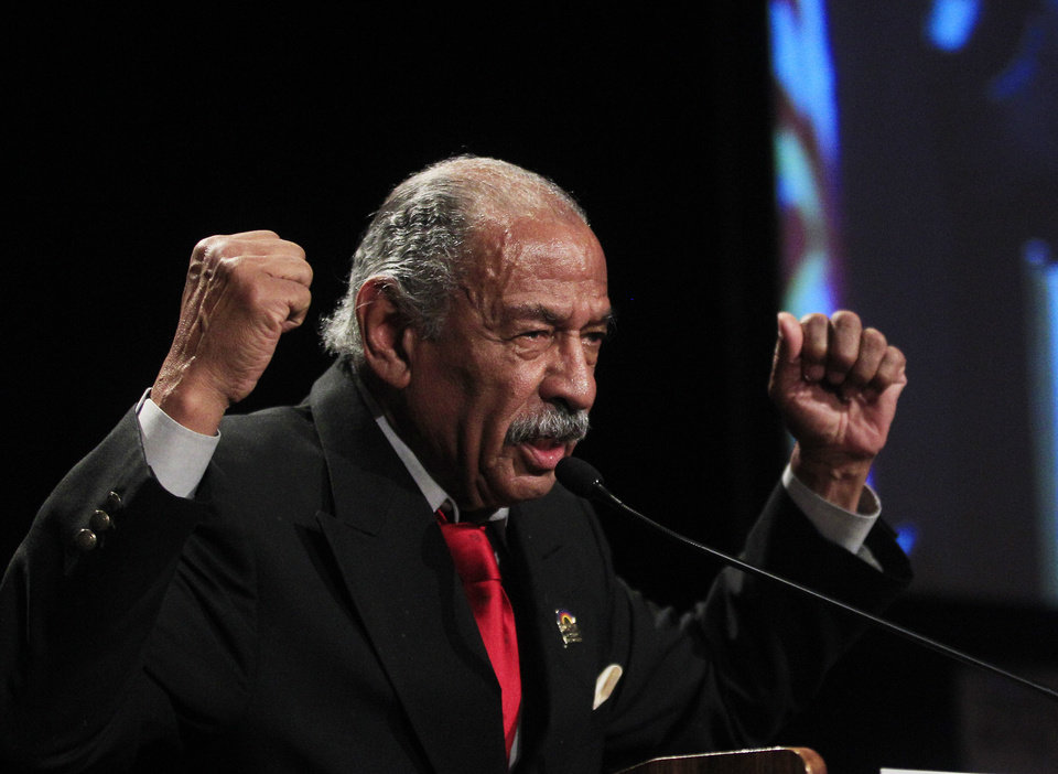 Rep. John Conyers, D-Mich., addresses supporters during the Michigan Democratic election night party at the MGM Grand Detroit, Tuesday, Nov. 6, 2012, in Detroit. (AP Photo/Carlos Osorio)