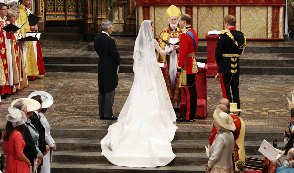 Photo - Britain's Prince William and his bride Kate Middleton exchange their vows during the wedding service at Westminster Abbey, London, Friday April 29, 2011. (AP Photo/Dave Thompson, Pool) ORG XMIT: RWBJ118