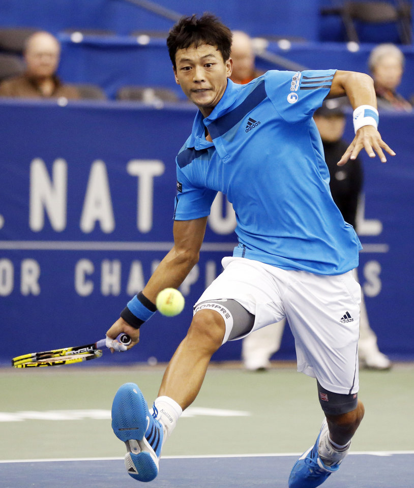 Photo - Lu Yen-Hsun, of Taiwan, hits a return to Denis Kudla during a second round match at the U.S. National Indoor Tennis  Championships on Thursday, Feb. 13, 2014, in Memphis, Tenn. (AP Photo/Rogelio V. Solis)