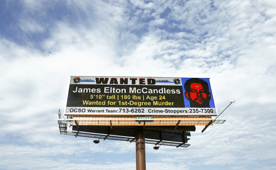 Photo - An electronic billboard flashes a wanted ad for James Elton McCandless Jr. on Interstate 44 between  Pennsylvania Avenue and May Avenue on Monday in Oklahoma City. Photo by Ashley McKee, The Oklahoman