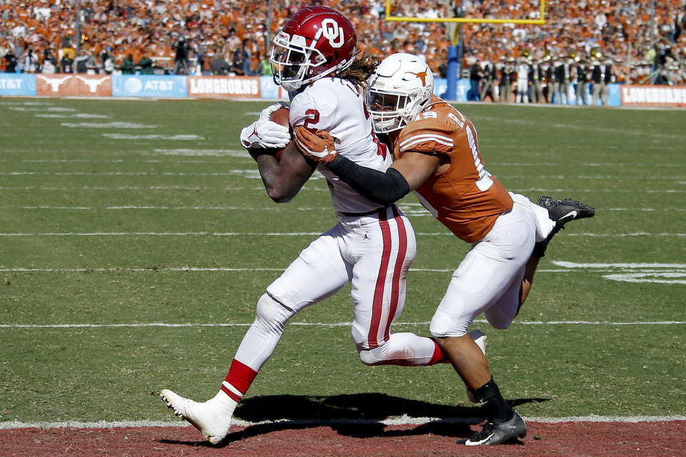 Record - Oklahoma large receiver CeeDee Lamb (2) rankings a touchdown in front of Texas defensive support Brandon Jones (19) at some point soon of the Crimson River Showdown college football sport between the University of Oklahoma Sooners (OU) and the Texas Longhorns (UT) at Cotton Bowl Stadium in Dallas, Saturday, Oct. 12, 2019. [Bryan Terry/The Oklahoman]