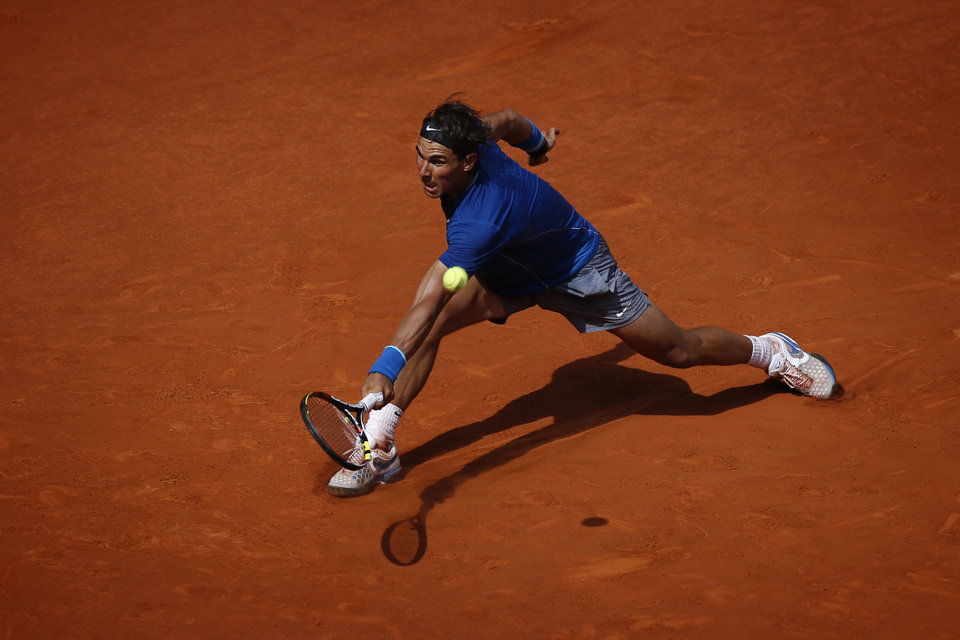 Photo - Rafael Nadal from Spain returns the ball during a Madrid Open tennis tournament match against Jarkko Nieminen, from Finland, in Madrid, Spain, Thursday, May 8, 2014. (AP Photo/Daniel Ochoa de Olza)