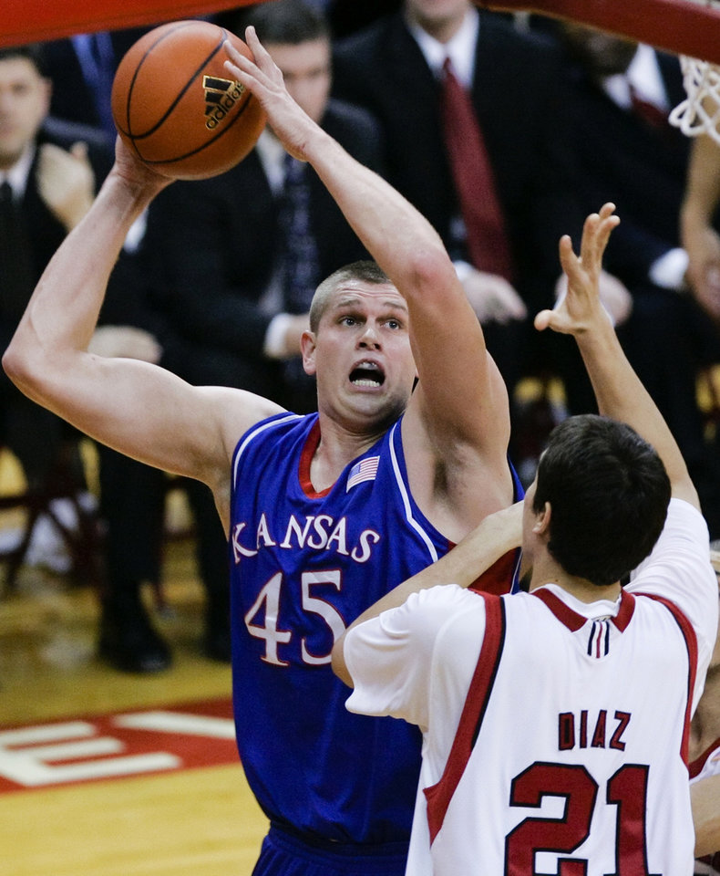 Photo - Kansas' Cole Aldrich (45) shoots over Nebraska's Jorge Brian Diaz in the first half of their NCAA college basketball game in Lincoln, Neb., Wednesday, Jan. 13, 2010.(AP Photo/Nati Harnik) ORG XMIT: NENH106