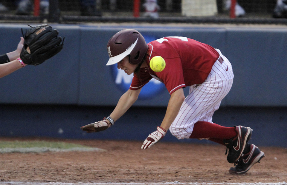 Photo - Alabama's Jazlyn Lunceford (2) slides into home during a Women's College World Series softball game between OU and Alabama at ASA Hall of Fame Stadium in Oklahoma City, Tuesday, June 5, 2012.  Photo by Garett Fisbeck, The Oklahoman