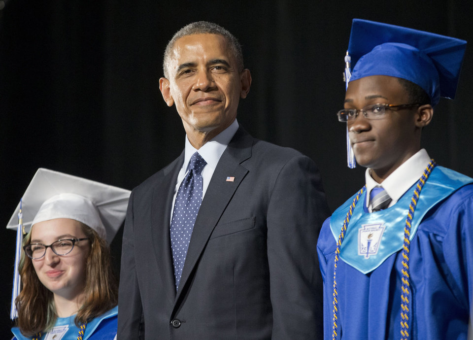 Photo - President Barack Obama, flanked by class Valedictorian Naomi Desilets, left, and student body President Reginald Sarpong,stands on stage prior to delivering the commencement address for Worcester Technical High School, Wednesday, June 11, 2014, in Worcester, Mass. (AP Photo/Pablo Martinez Monsivais)