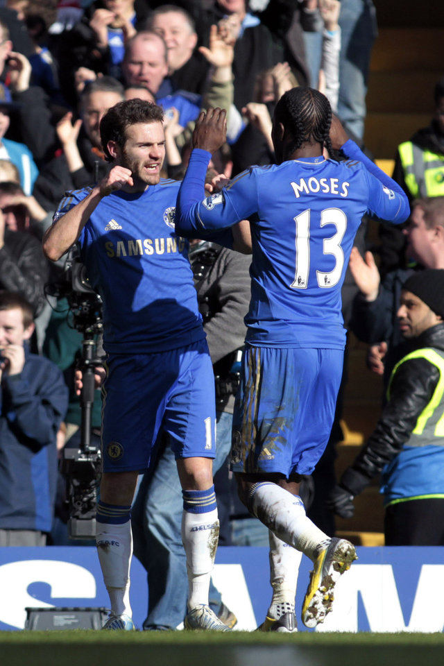 Photo - Chelsea's Juan Mata, left, celebrates his goal against Brentford with teammate Victor Moses during their English FA Cup fourth round replay soccer match at Stamford Bridge, London, Sunday, Feb. 17, 2013. (AP Photo/Sang Tan)