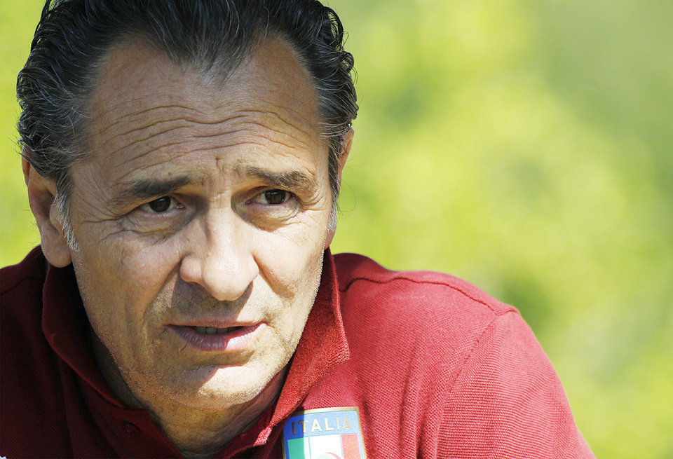 Photo - Cesare Prandelli, coach of the Italian national soccer team, leads a training session at the Coverciano center, near Florence, Italy, Monday, June 2, 2014. Giuseppe Rossi will miss out on the World Cup once again. The American-born Italy forward was among the players cut from the Azzurri's final World Cup squad on Saturday, in a repeat of what happened to him four years ago. Cesare Prandelli apparently judged that Rossi hadn't fully recovered from his latest right knee injury in January. Rossi has always been one of Prandelli's favorite players, but the coach opted not to gamble on his fitness despite the forward having been the Italian league's leading scorer before getting injured. (AP Photo/Fabrizio Giovannozzi)