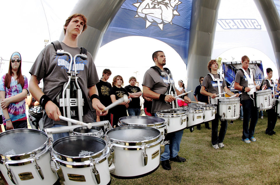 Members of the SWOSU drum line host a clinic for high school bands as part of Band Day activities at the state fair on Monday, Sep. 17, 2012.  Drummer at left is Josh Hoffert, a freshman at Southwestern Oklahoma State University.  Photo by Jim Beckel, The Oklahoman.