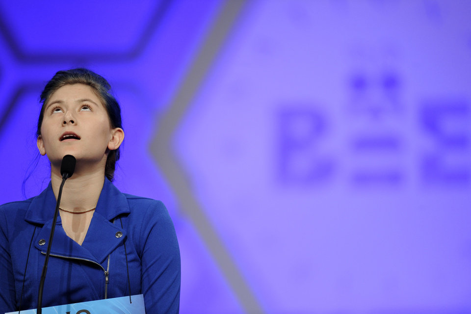 Photo - Oona Flood, 14, of San Diego, Calif., correctly spells her word during the third round of the 2015 Scripps National Spelling Bee in Oxon Hill, Md., Wednesday, May 27, 2015. (AP Photo/Cliff Owen)