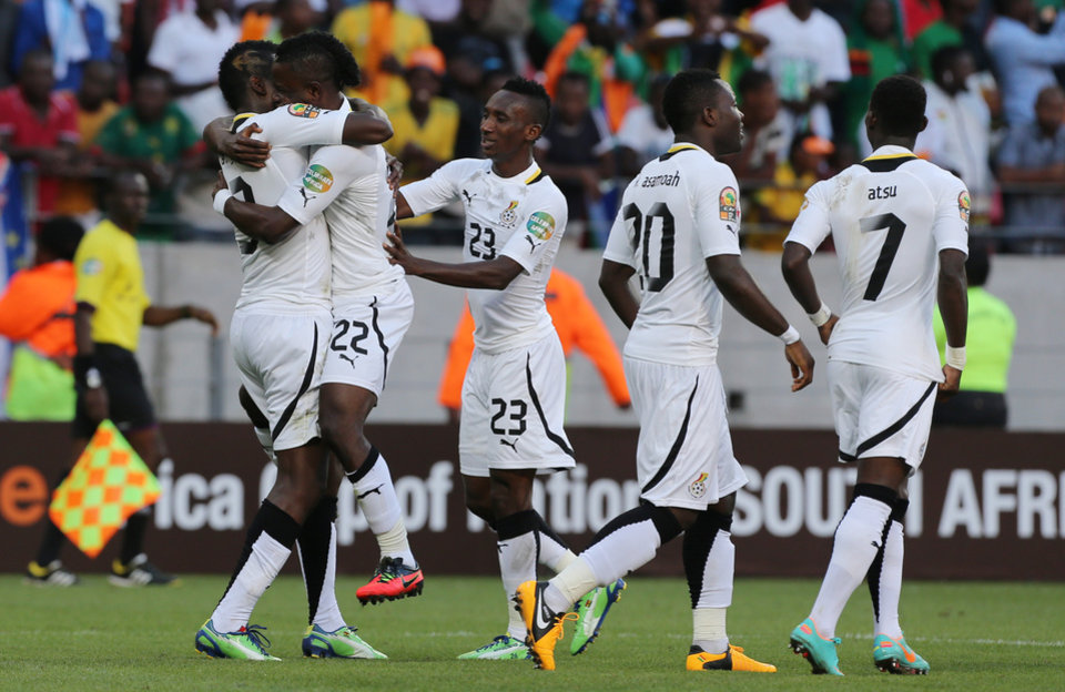 Photo - Ghana's Wakaso Mubarak, second from left, celebrates with teammates after scoring his second goal during their quarter final of the African Cup of Nations  soccer match against Cape Verde at the Nelson Mandela Bay Stadium in Port Elizabeth, South Africa, Saturday Feb. 2, 2013. (AP Photo/Themba Hadebe)