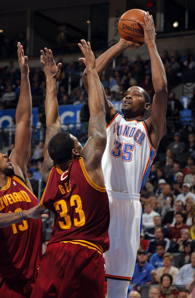 Oklahoma City's Kevin Durant (35) shoots as Cleveland's Tristan Thompson (13) and Alonzo Gee (33) defend during the NBA basketball game between the Oklahoma City Thunder and the Cleveland Cavaliers at the Chesapeake Energy Arena, Sunday, Nov. 11, 2012. Photo by Sarah Phipps, The Oklahoman