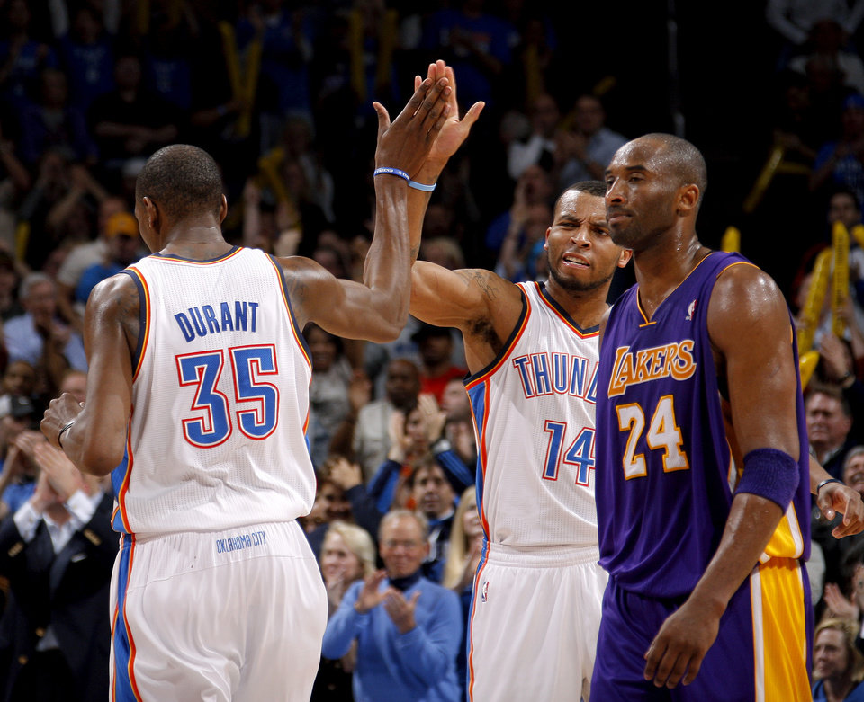 Oklahoma City\'s Daequan Cook (14) and Kevin Durant (35) celebrate beside Los Angeles\' Kobe Bryant (24) during an NBA basketball game between the Oklahoma City Thunder and the Los Angeles Lakers at Chesapeake Energy Arena in Oklahoma City, Thursday, Feb. 23, 2012. Oklahoma City won 100-85. Photo by Bryan Terry, The Oklahoman