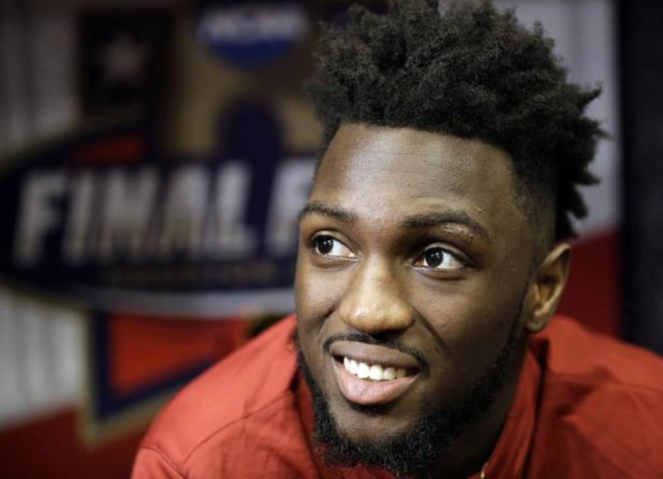 Photo - Oklahoma's Khadeem Lattin answers questions before a practice session for the NCAA Final Four college basketball tournament Thursday, March 31, 2016, in Houston. (AP Photo/Eric Gay)