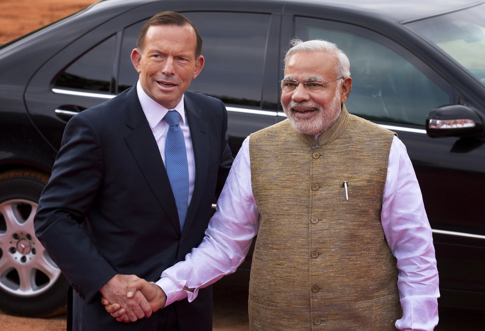 Photo - Australian Prime Minister Tony Abbott, left, poses with his Indian counterpart Narendra Modi for a photo in New Delhi, India, Friday, Sept. 5, 2014. Abbott is on a two-day visit to India. (AP Photo/Saurabh Das)