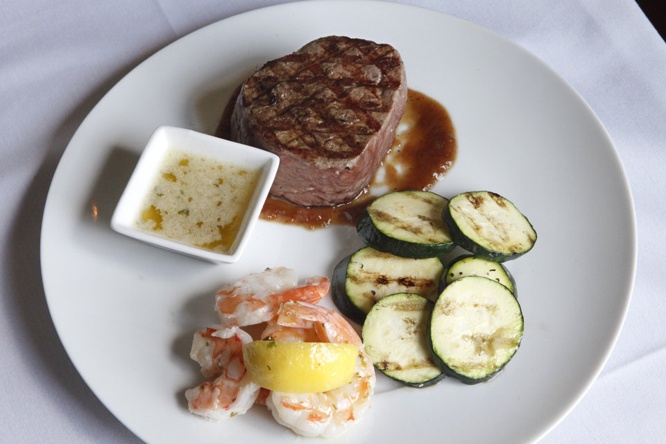 Photo - Steak, shrimp and grilled vegetables at Twelve Oaks Restaurant , Thursday, May 22, 2014. Twelve Oaks Restaurant was founded by Bill Horn, who bought and moved an aging Victorian home in Guthrie to its current location south of the Lazy E. Bill died two years ago, and his daughter Lisa Janes had to either sell it or drop her successful nursing career in Dallas and move back to Oklahoma to keep her father's dream alive .  Photo by David McDaniel, The Oklahoman   David McDaniel - The Oklahoman