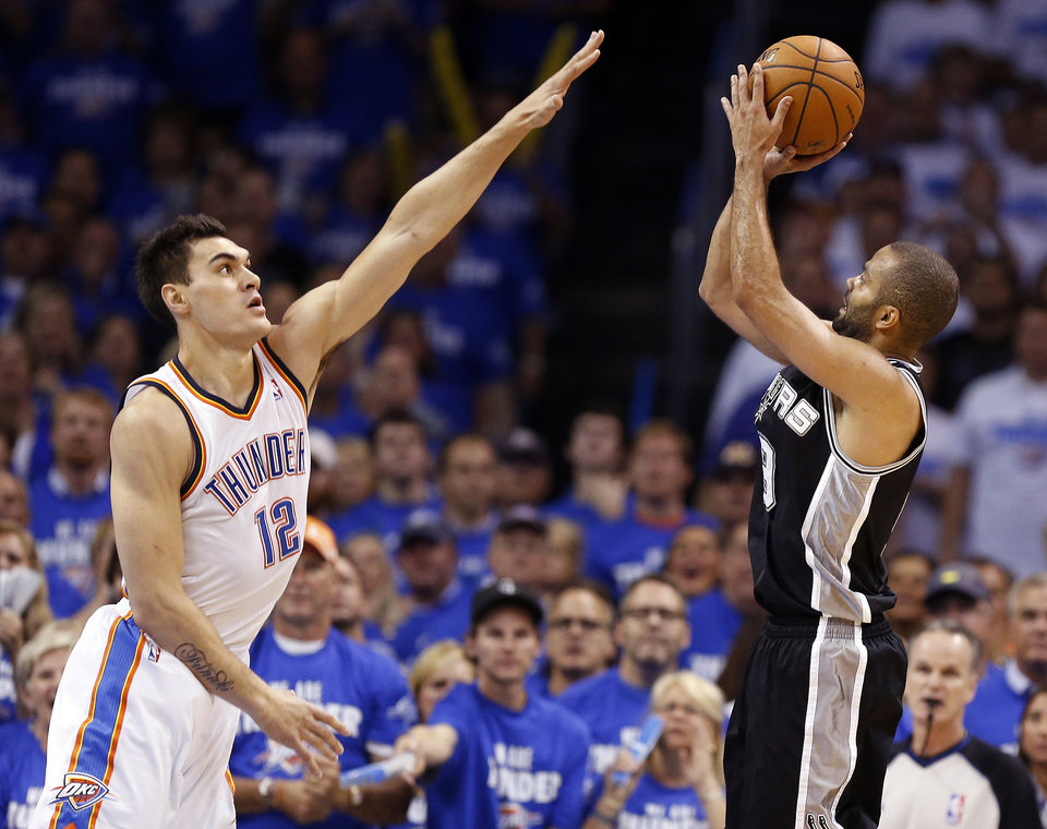 Oklahoma City's Steven Adams (12) defends as San Antonio's Tony Parker (9) shoots during Game 4 of the Western Conference Finals in the NBA playoffs between the Oklahoma City Thunder and the San Antonio Spurs at Chesapeake Energy Arena in Oklahoma City, Tuesday, May 27, 2014. Photo by Nate Billings, The Oklahoman