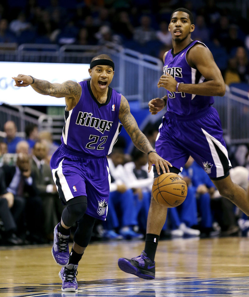 Sacramento Kings' Isaiah Thomas (22) directs teammates with Jason Thompson, right, against the Orlando Magic during the first half of an NBA basketball game, Wednesday, Feb. 27, 2013, in Orlando, Fla. (AP Photo/John Raoux)