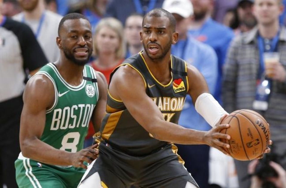 Photo -  Oklahoma City's Chris Paul (3) looks to pass away from Boston's Kemba Walker (8) during the Celtics' win against the Thunder on Feb. 9 at Chesapeake Energy Arena. [Nate Billings/The Oklahoman]