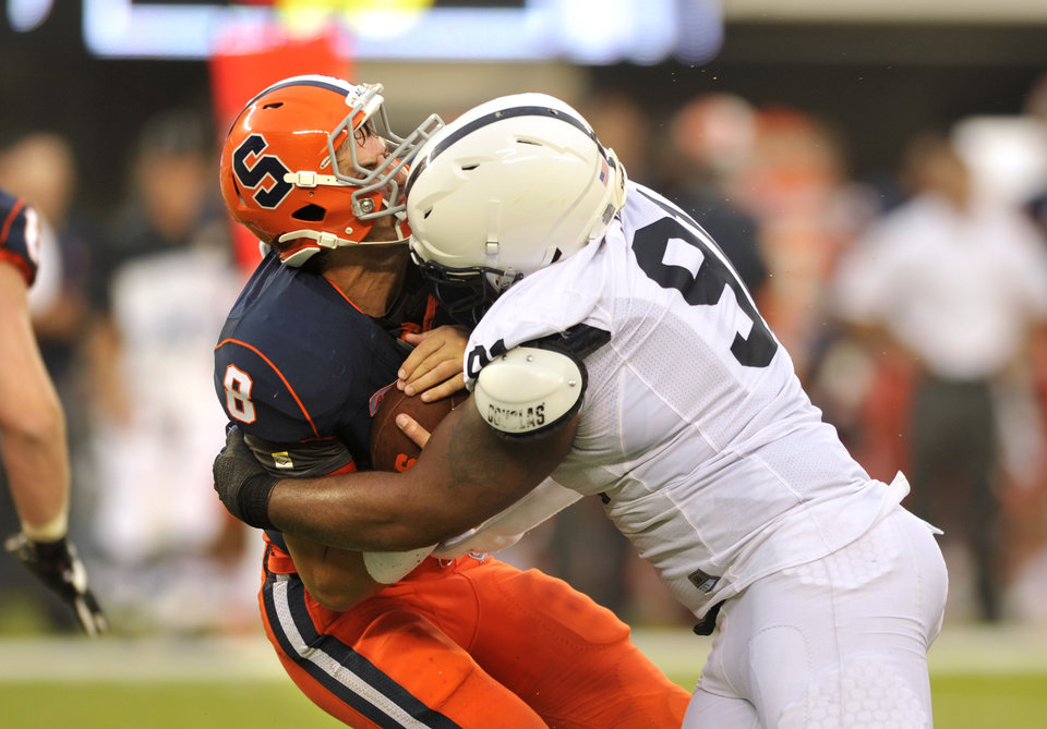Syracuse quarterback Drew Allen is sacked during his team's season-opening loss to Penn State last weekend. Allen transferred from OU. AP PHOTO