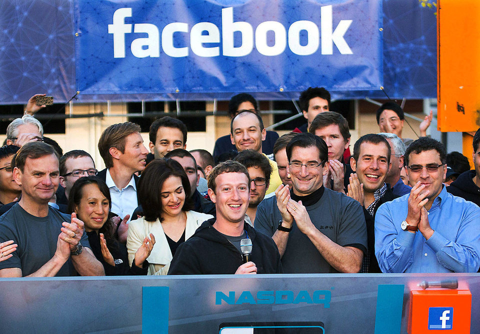 Photo - Facebook founder, Chairman and CEO Mark Zuckerberg, center, rings the Nasdaq opening bell May 18 from Facebook headquarters in Menlo Park, Calif. AP Archives Photo