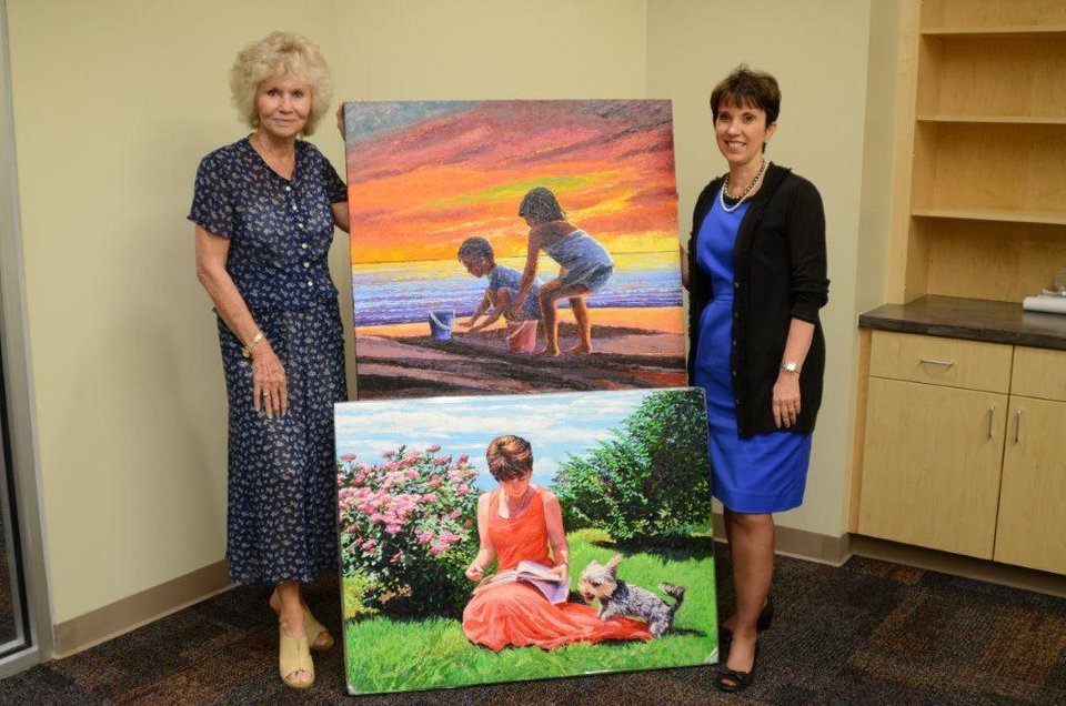 Photo - Renowned artist Lee Reams with two of her paintings. PHOTO PROVIDED.