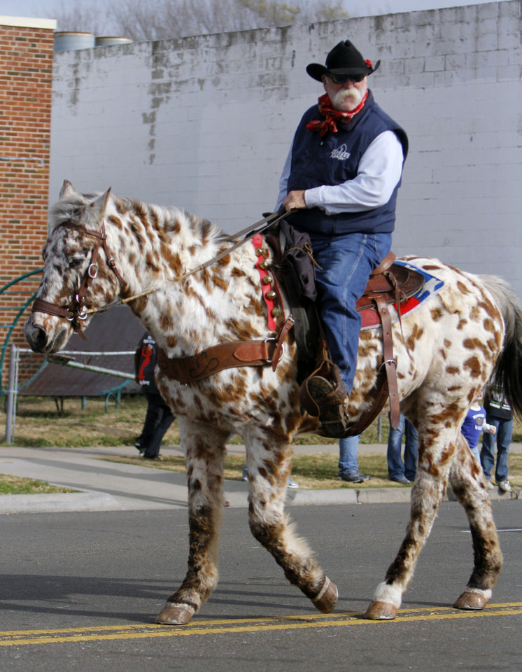 Former Oklahoma City Blazers Head coach Doug Sauter rides in the Stockyards City Christmas parade in Oklahoma City, OK, Saturday, December 1, 2012,  By Paul Hellstern, The Oklahoman
