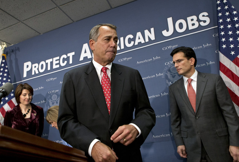 Photo - Speaker of the House John Boehner, R-Ohio, joined by Rep. Cathy McMorris Rodgers, left, and House Majority Leader Eric Cantor, R-Va., right, as they finish a news conference about the fiscal cliff negotiations after a closed-door GOP strategy session, at the Capitol in Washington, Tuesday, Dec. 18, 2012.   (AP Photo/J. Scott Applewhite)
