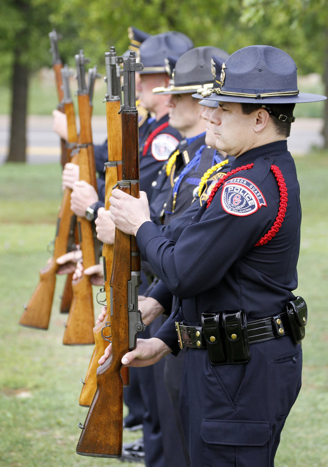 Members of the Cleveland County Multi-Agency Honor Guard present arms during the Oklahoma Law Enforcement Officers Memorial Service in Oklahoma City , Friday May 10, 2013. Photo By Steve Gooch, The Oklahoman