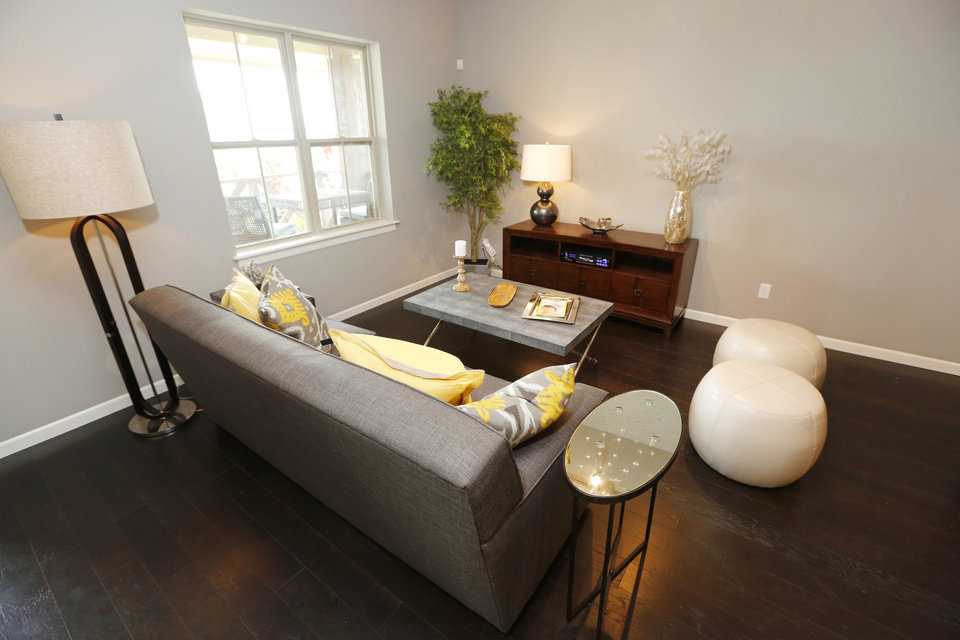 Photo - A living area in a model townhome in Hawthorn addition in The Village.  Steve Gooch - The Oklahoman