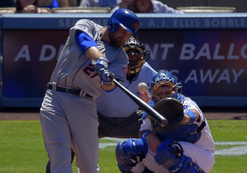 Photo - New York Mets' Lucas Duda, left, hits a three-run home run as Los Angeles Dodgers catcher A.J. Ellis, right, and home plate umpire Dale Scott look on during the third inning of a baseball game, Sunday, Aug. 24, 2014, in Los Angeles. (AP Photo/Mark J. Terrill)