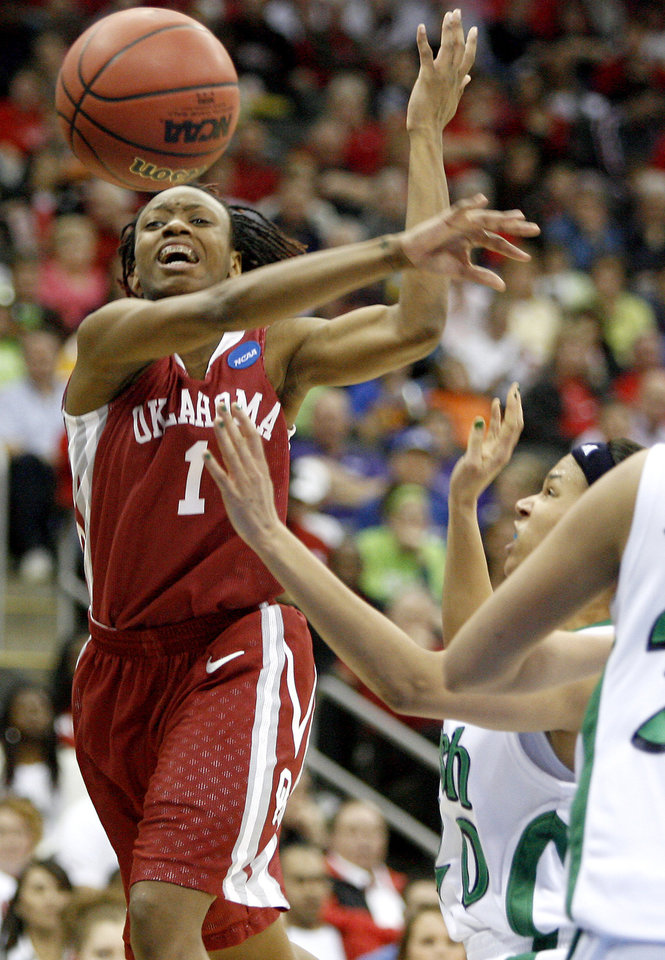 Photo - OU's Nyeshia Stevenson passes the ball around Notre Dame's Ashley Barlow during the Sweet 16 round of the NCAA women's  basketball tournament in Kansas City, Mo., on Sunday, March 28, 2010. 