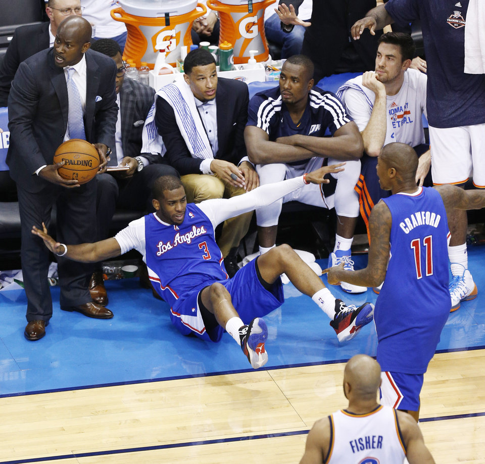 Photo - Chris Paul (3) reacts after Steven Adams fouled him during Game 2 of the Western Conference semifinals in the NBA playoffs between the Oklahoma City Thunder and the Los Angeles Clippers at Chesapeake Energy Arena in Oklahoma City, Wednesday, May 7, 2014. Photo by Sarah Phipps, The Oklahoman