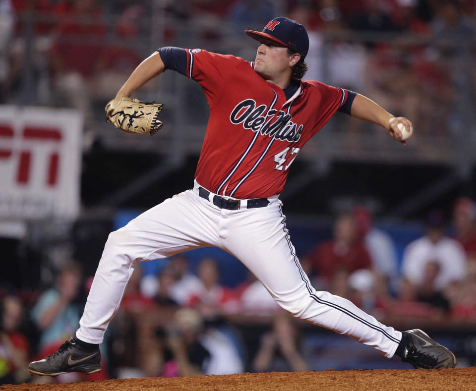 Photo - Mississippi pitcher Christian Trent (47) pitches in the second inning of an NCAA college baseball tournament super regional game against Louisiana Lafayette in Lafayette, La.,Sunday, June 8, 2014. (AP Photo/Gerald Herbert)