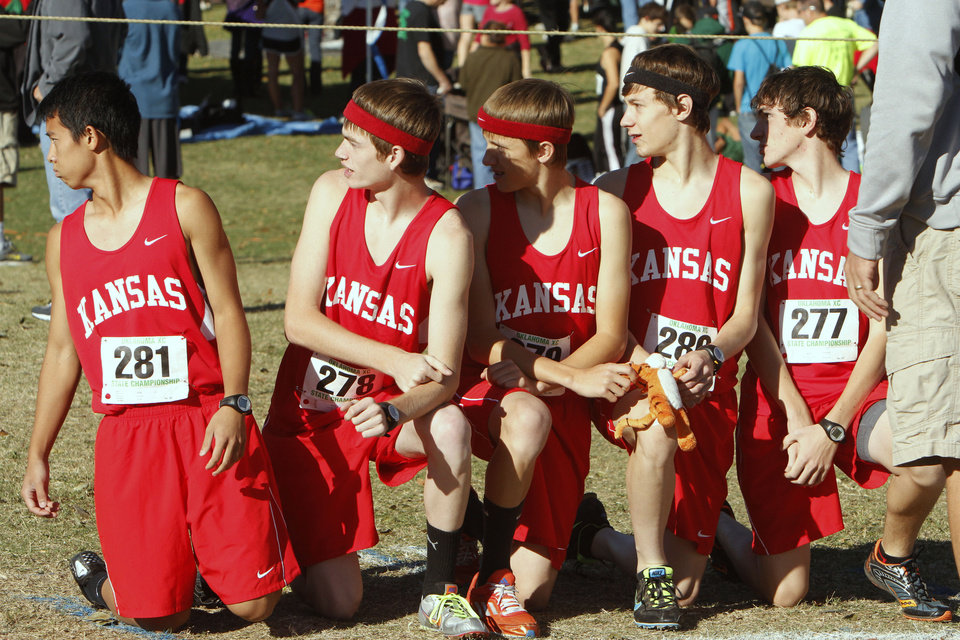 Photo - Kansas, OK runners wait for one of their teammates before the start of the class 3A boys State cross country meet at Gordon Cooper Vo-Tech in Shawnee, OK, Saturday, October 20, 2012,  By Paul Hellstern, The Oklahoman