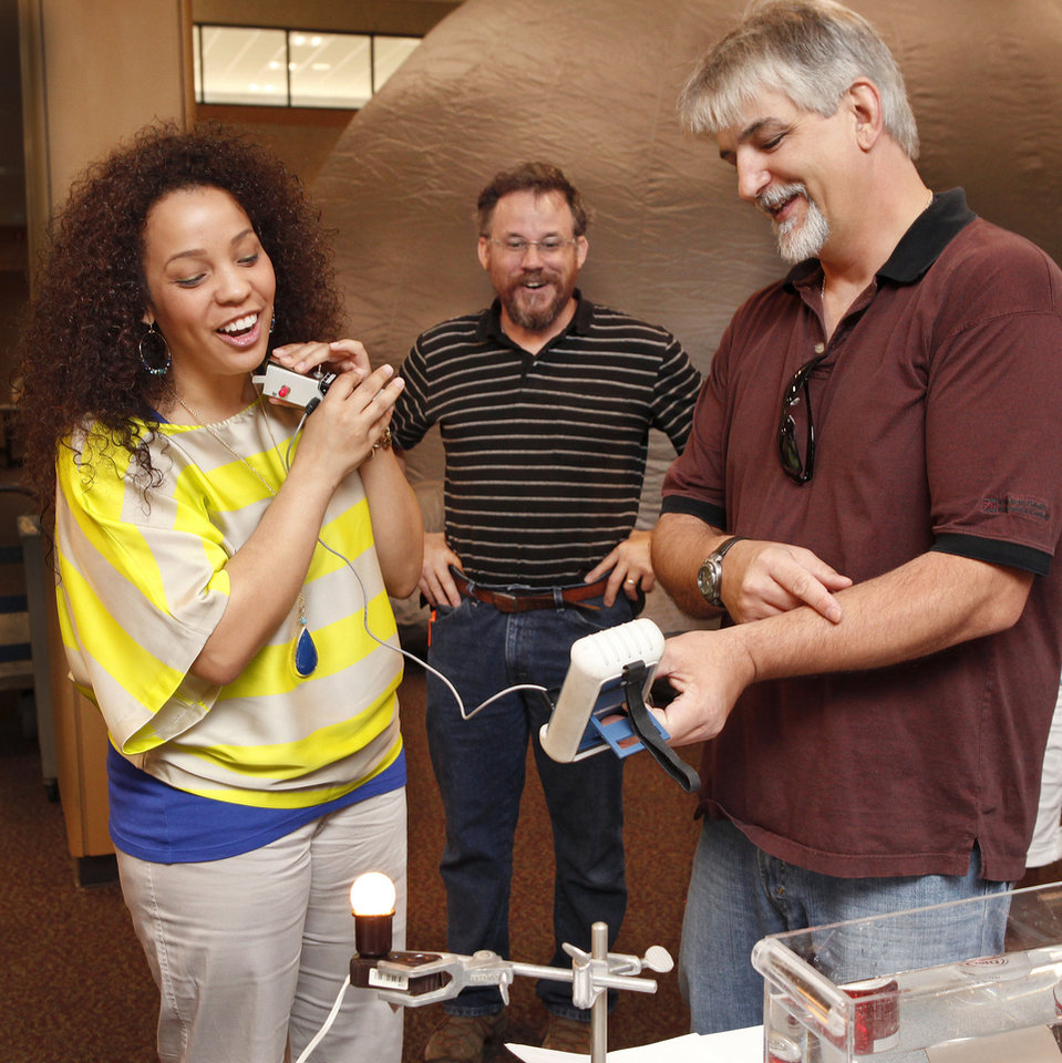 Photo - Rose State College student  Rebecca Esquibel measures heat from her neck as students Ron Perez-Guerra, right,  and Don  Blankenship look on.   Photo by Jim Beckel, The Oklahoman
