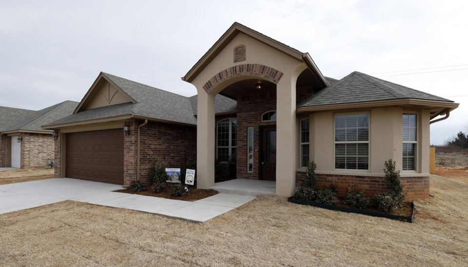 Photo - First Oklahoma Construction built this home at 709 Summit Hollow Drive in the Summit Lake Villas addition in Norman.  STEVE SISNEY -