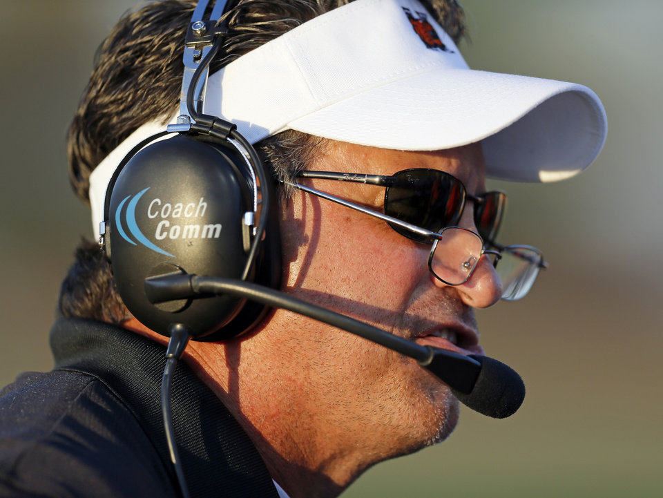 Photo - Norman coach Greg Nation talks to a player during a high school football game between Moore and Norman in Moore, Okla., Thursday, Sept. 6, 2012. Photo by Nate Billings, The Oklahoman