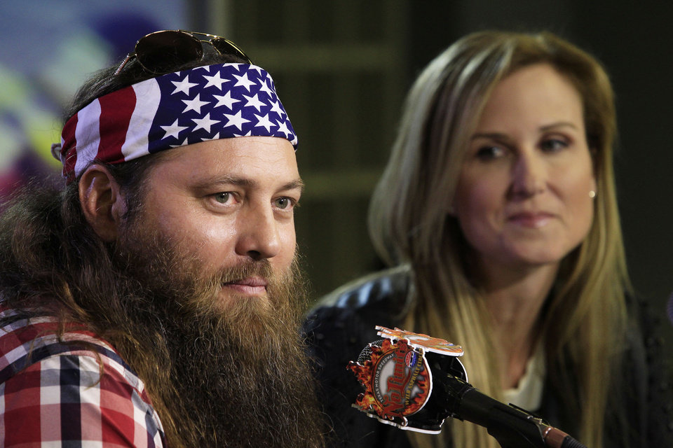 Photo - Duck Dynasty stars Willie and Korie Robertson at Texas Motor Speedway as they debuted their new Big Hoss TV, a 218 x 94 foot screen over the east grandstands of the racetrack, Wednesday, March 19, 2014. The first show to be seen on the screen by the public is Wednesday's episode of