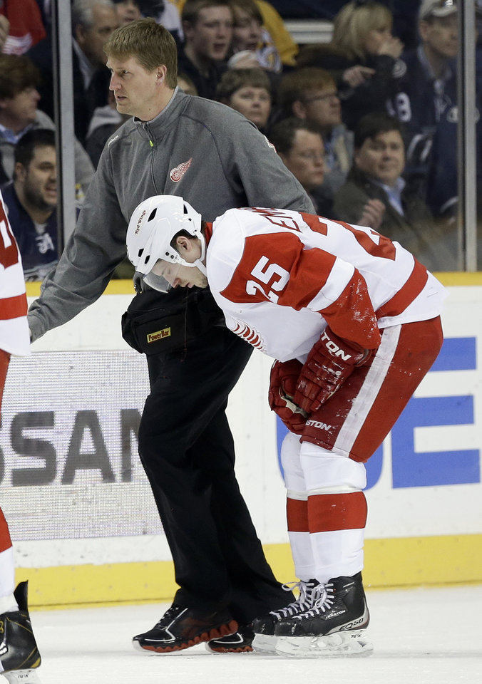 Detroit Red Wings center Cory Emmerton (25) is helped off the ice during the first period of an NHL hockey game against the Detroit Red Wings on Tuesday, Feb. 19, 2013, in Nashville, Tenn. (AP Photo/Mark Humphrey)
