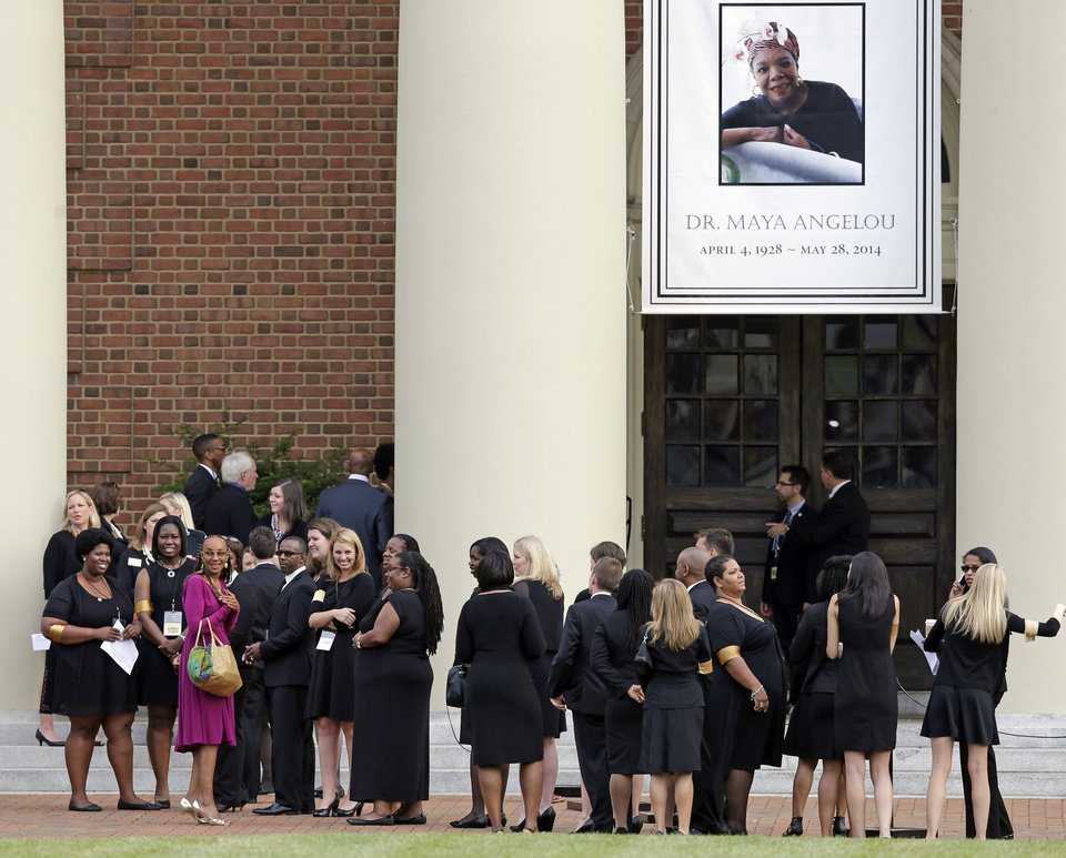 Photo - Mourners wait outside Wait Chapel before a memorial service for poet and author Maya Angelou at Wait Chapel. at Wake Forest University in Winston-Salem, N.C., Saturday, June 7, 2014. Former President Bill Clinton and Oprah Winfrey are joining First Lady Michelle Obama at the service. (AP Photo/Chuck Burton)