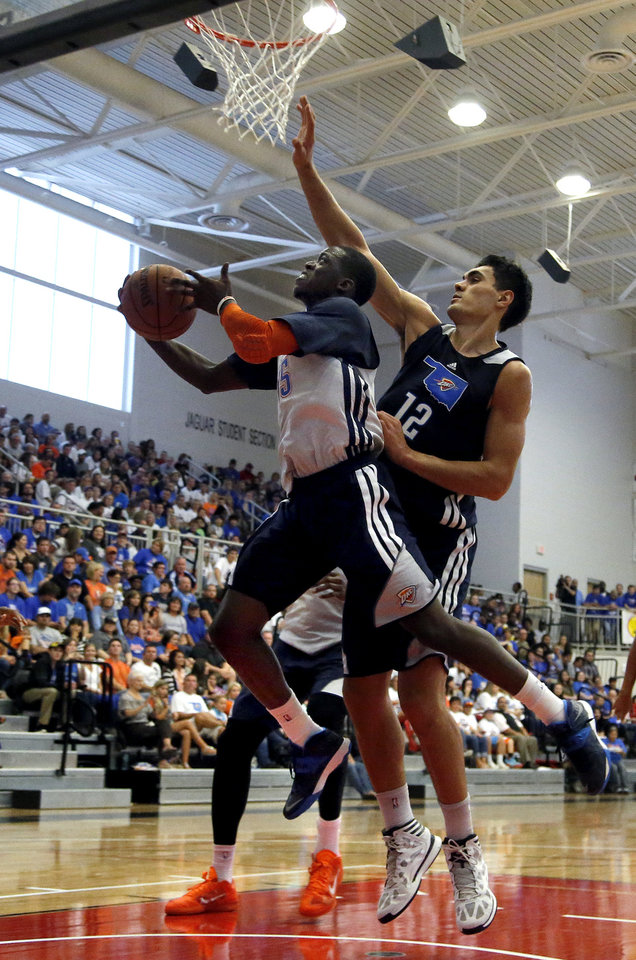 Photo - Oklahoma City's Reggie Jackson (15) shoots a lay up as Steven Adams (12) during the Oklahoma City Thunder's  Blue and White scrimmage at Westmoore High School in Moore, Okla., Sunday, Oct. 13, 2013. PHOTO BY SARAH PHIPPS, The Oklahoman
