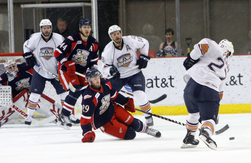 Oklahoma City Barons Taylor Fedun shoots through the Grand Rapids Griffins defense in the fourth game of the Western Conference finals of the AHL on June 1, 2013. Photo by KT KING, The Oklahoman ORG XMIT: OKC1306012126251028